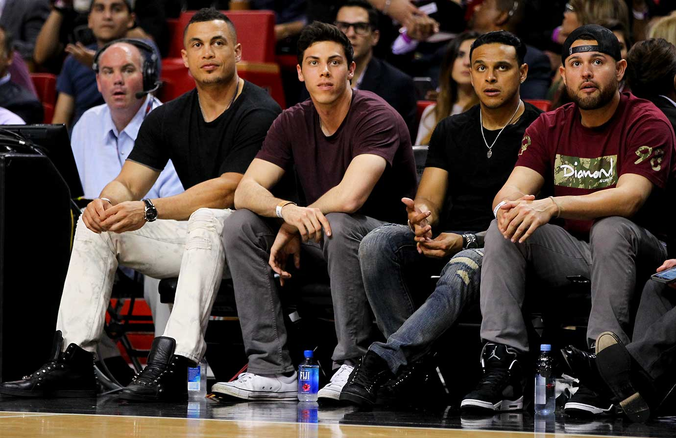 Major leaguers Giancarlo Stanton, Christian Yelich, A. J. Ramos and Ricky Nolasco at the Heat-Warriors game.