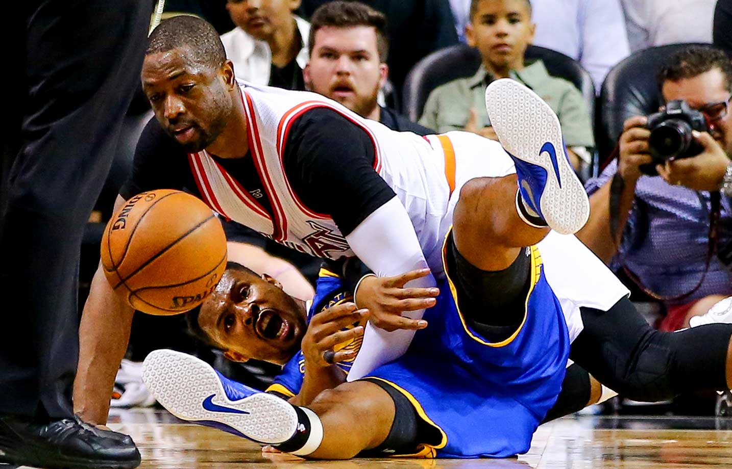 Dwyane Wade of the Miami Heat and Leandro Barbosa of Golden State Warriors get tangled up.