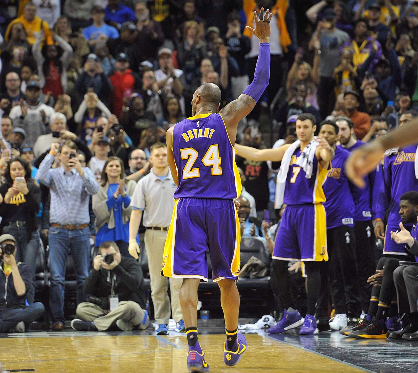 Kobe Bryant waves to fans as he leaves the court during his last game in Memphis.