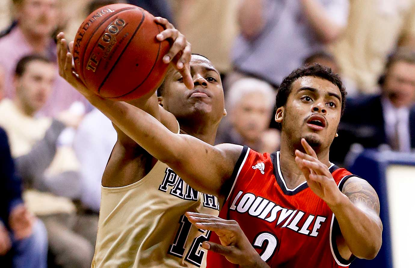 Pittsburgh's Chris Jones defends Louisville's Quentin Snider as he shoots.