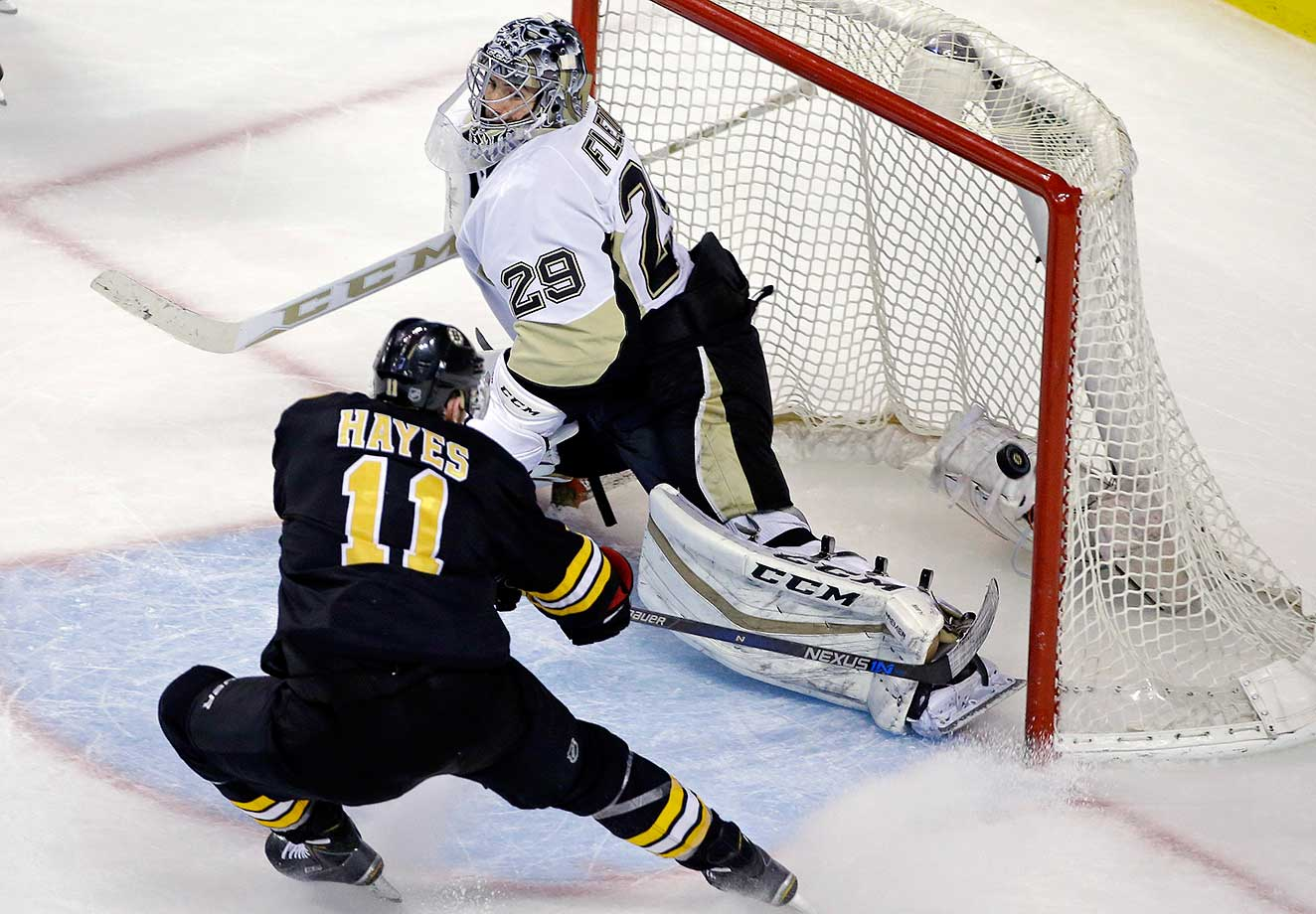 Boston's Jimmy Hayes scores against Pittsburgh goalie Marc-Andre Fleury.