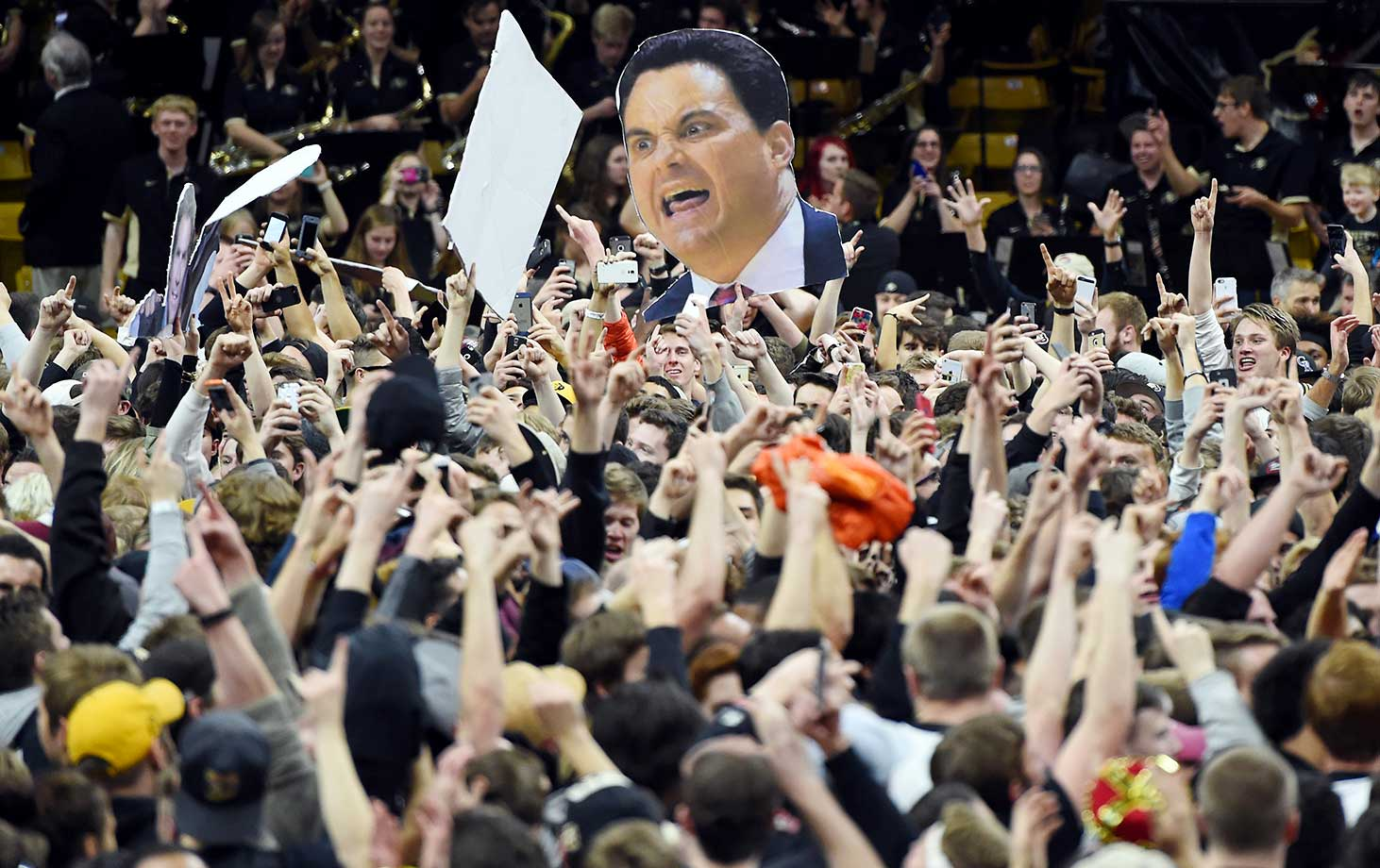 Colorado fans storm the court after the Buffaloes defeated Arizona 75-72.