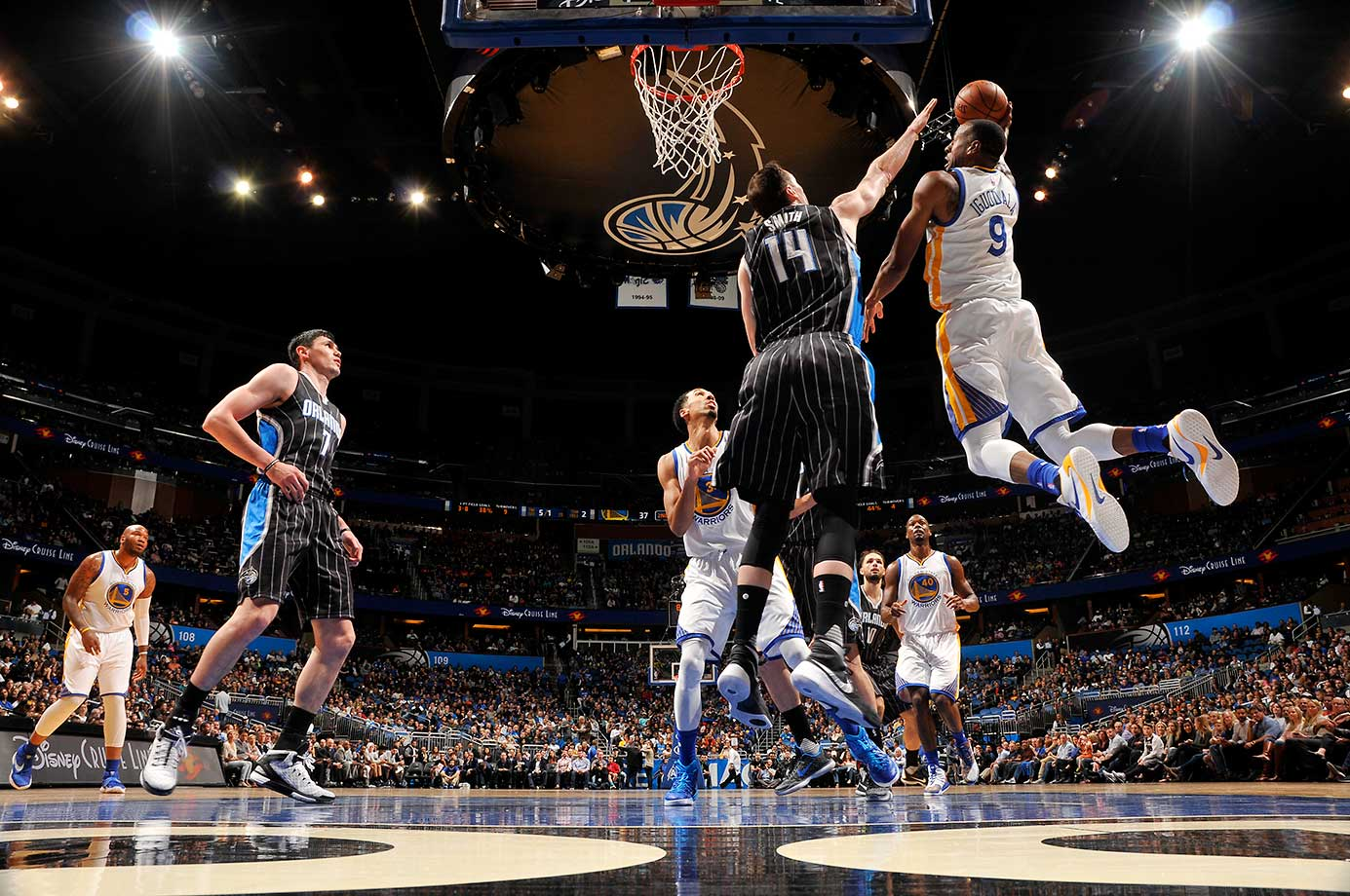Andre Iguodala of Golden State goes to the basket against Jason Smith of Orlando.
