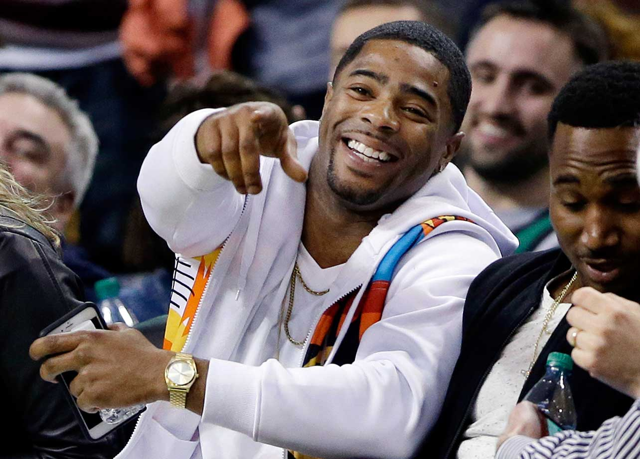 Super Bowl 49 hero Malcolm Butler laughs while watching the Boston Celtics and Milwaukee Bucks.
