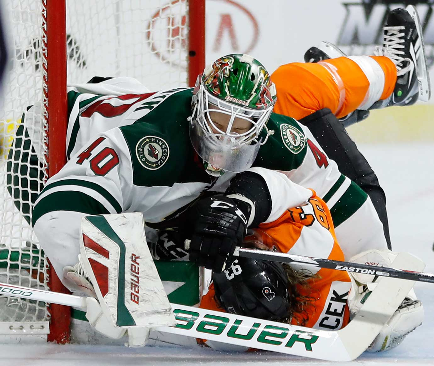 Jakub Voracek (93) of Philadelphia collides with Devan Dubnyk of Minnesota.