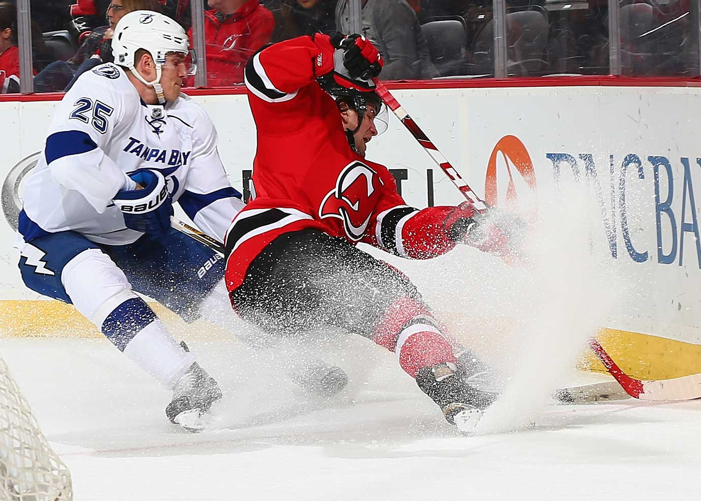 Bobby Farnham of the New Jersey Devils and Matthew Carle of Tampa Bay battle for the puck.