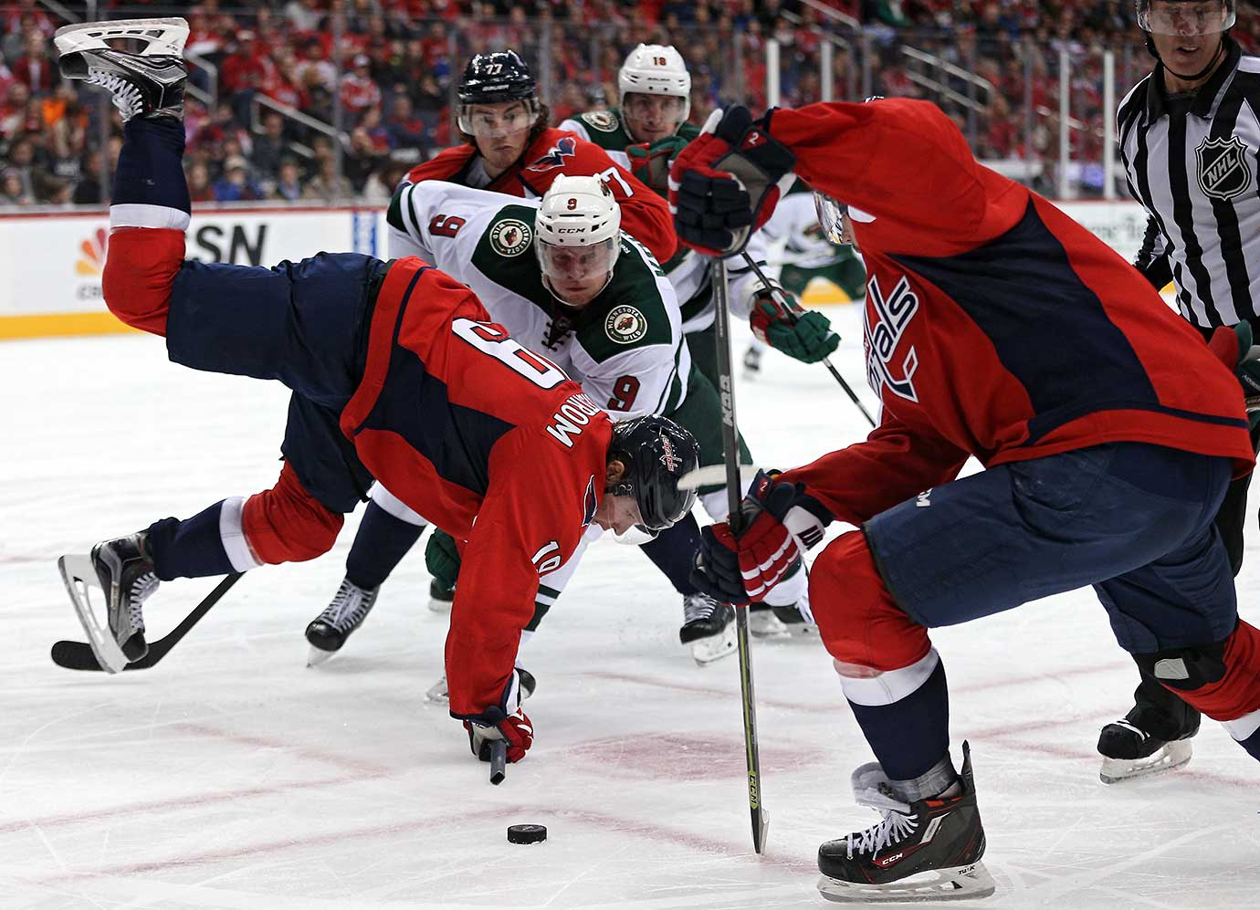 Nicklas Backstrom of the Washington Capitals is upended by Mikko Koivu of Minnesota.