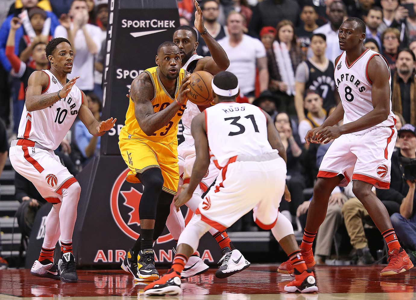 LeBron James of the Cleveland Cavaliers is heavily covered by the Toronto Raptors.