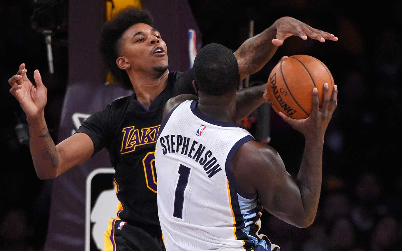 Lakers forward Nick Young blocks the shot of Memphis forward Lance Stephenson.
