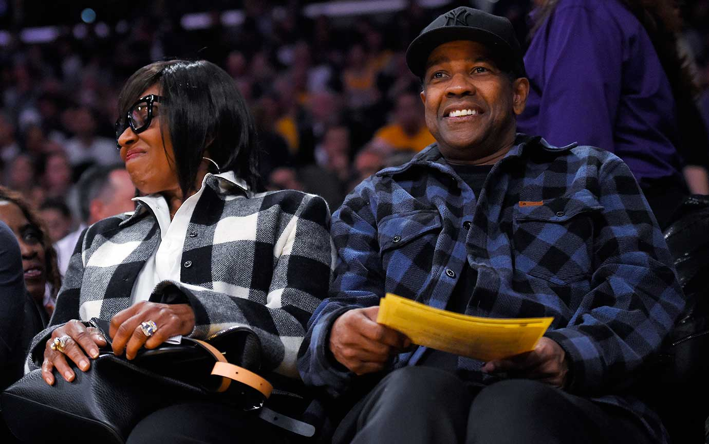 Denzel Washington sits with his wife, Pauletta, during the Lakers-Grizzlies game in L.A.