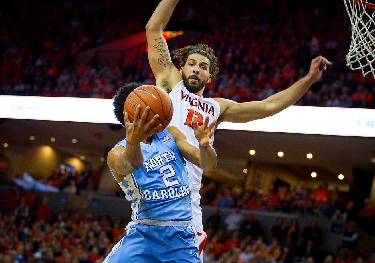 Virginia forward Anthony Gill goes high for a potential block during a win over North Carolina.