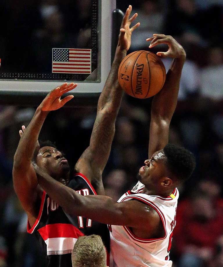 Ed Davis of the Portland Trail Blazers blocks a shot by Bobby Portis of the Chicago Bulls.