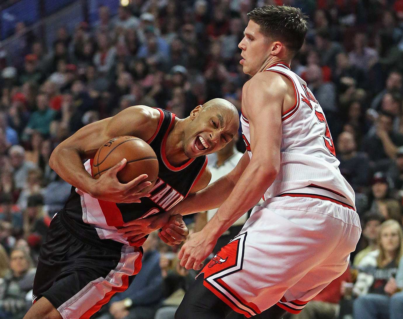 Damian Lillard of the Portland Trail Blazers drives against Doug McDermott of the Chicago Bulls.