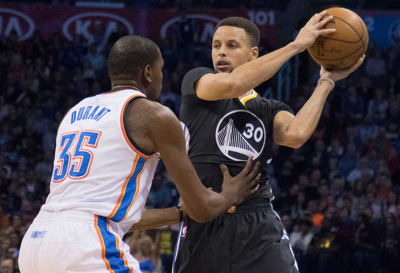 Stephen Curry looks for a play as Kevin Durant applies pressure. Durant fouled out of the game.