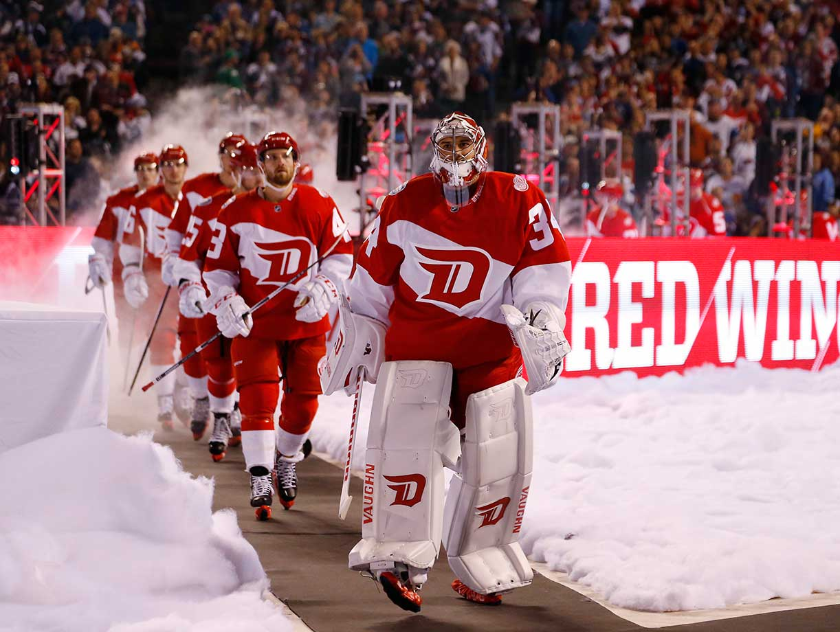 Detroit goalie Petr Mrazek leads his teammates to the ice to face the Colorado Avalanche at Coors Field in Denver.