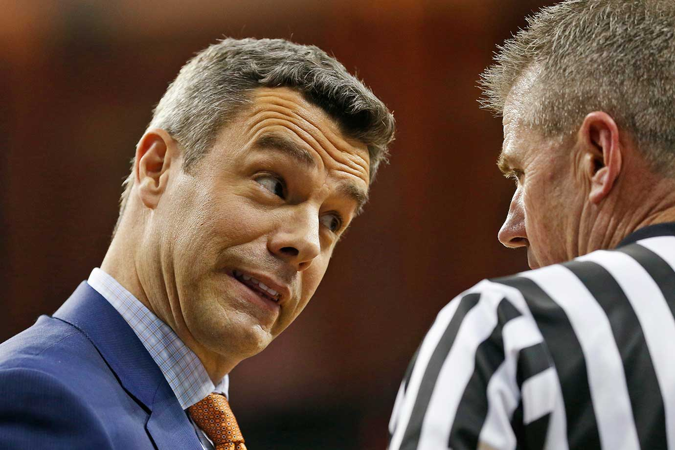 Virginia coach Tony Bennett questions a referee during a 79-74 win over North Carolina in Charlottesville, Va.