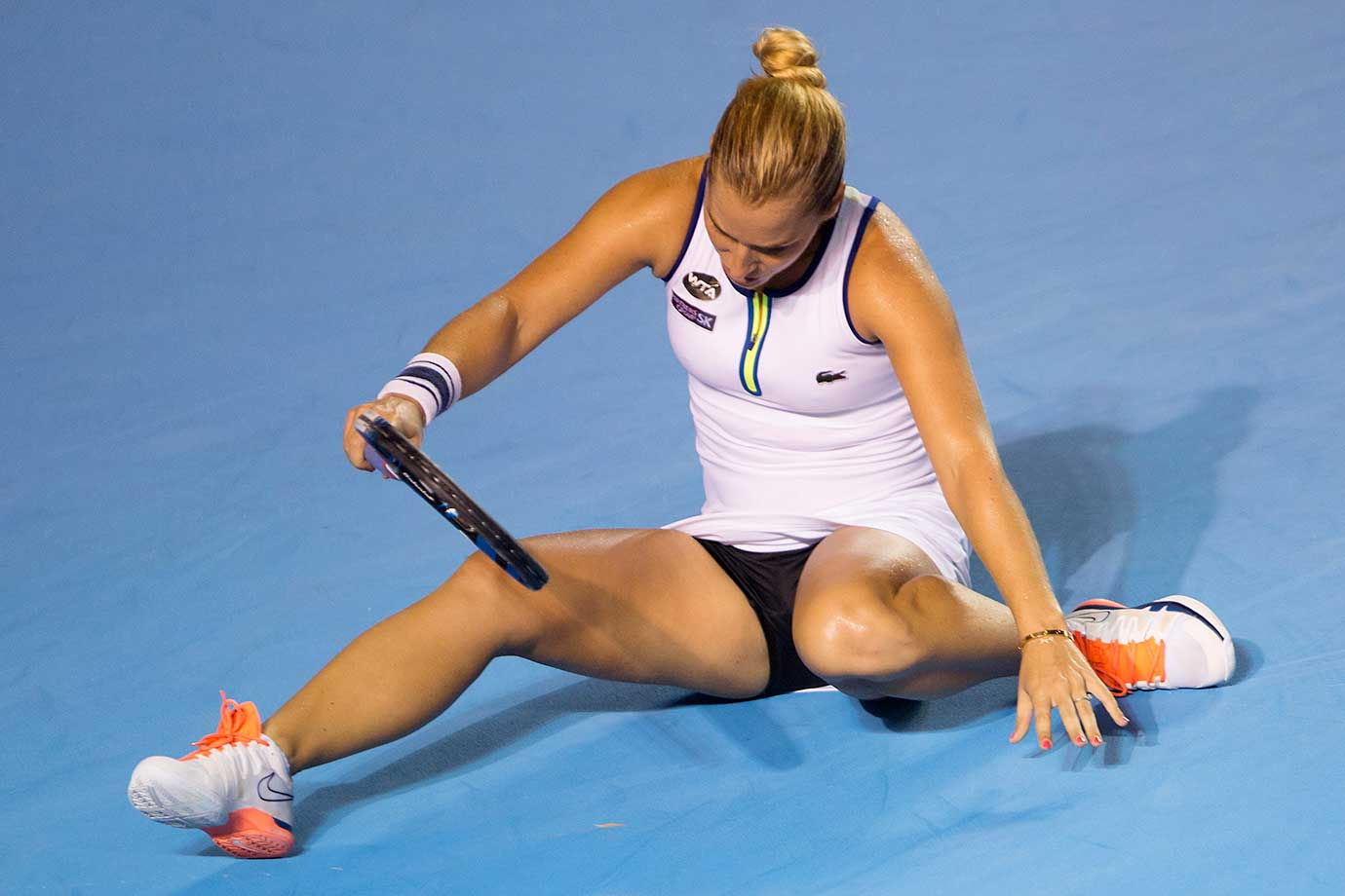 Dominika Cibulkova of Slovakia gets up while playing Sloane Stephens in the final of the Mexico Open in Acapulco.