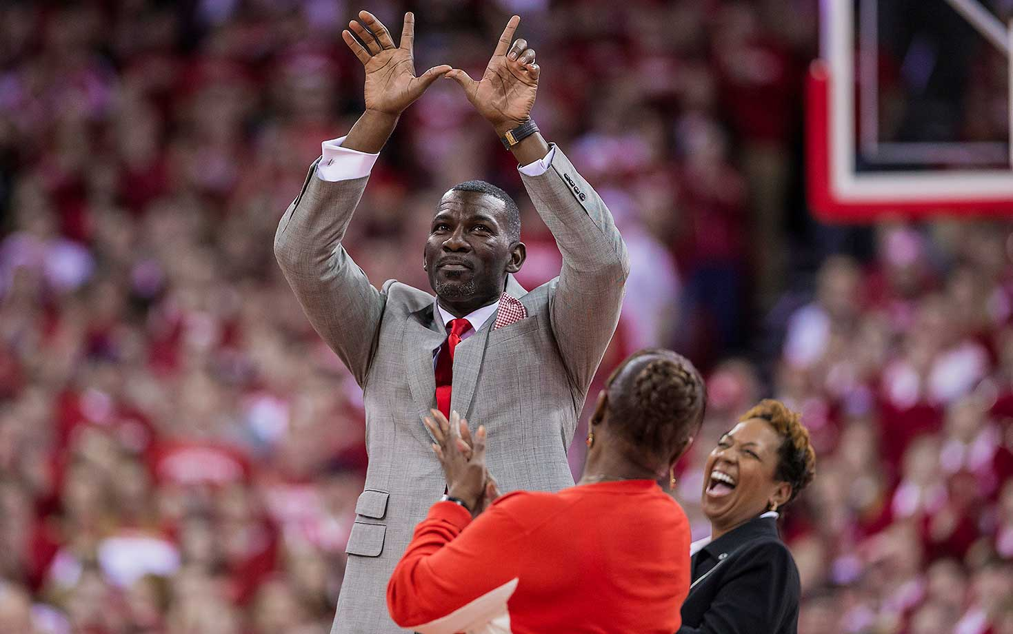 Former Wisconsin basketball player Michael Finley is introduced during a timeout of Sunday's game against Michigan.