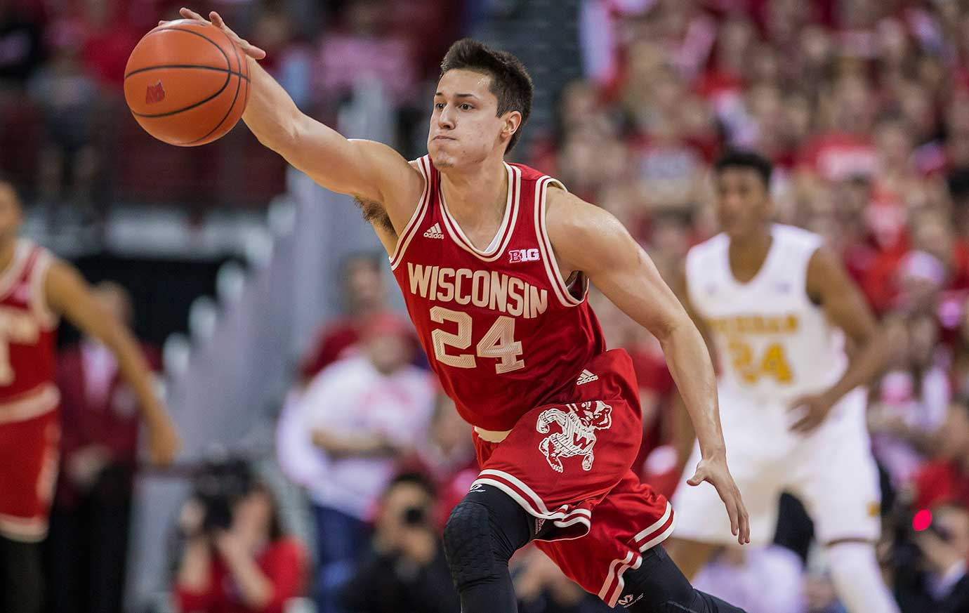 Wisconsin guard Bronson Koenig makes a play on a loose ball during a 68-57 win over Michigan.