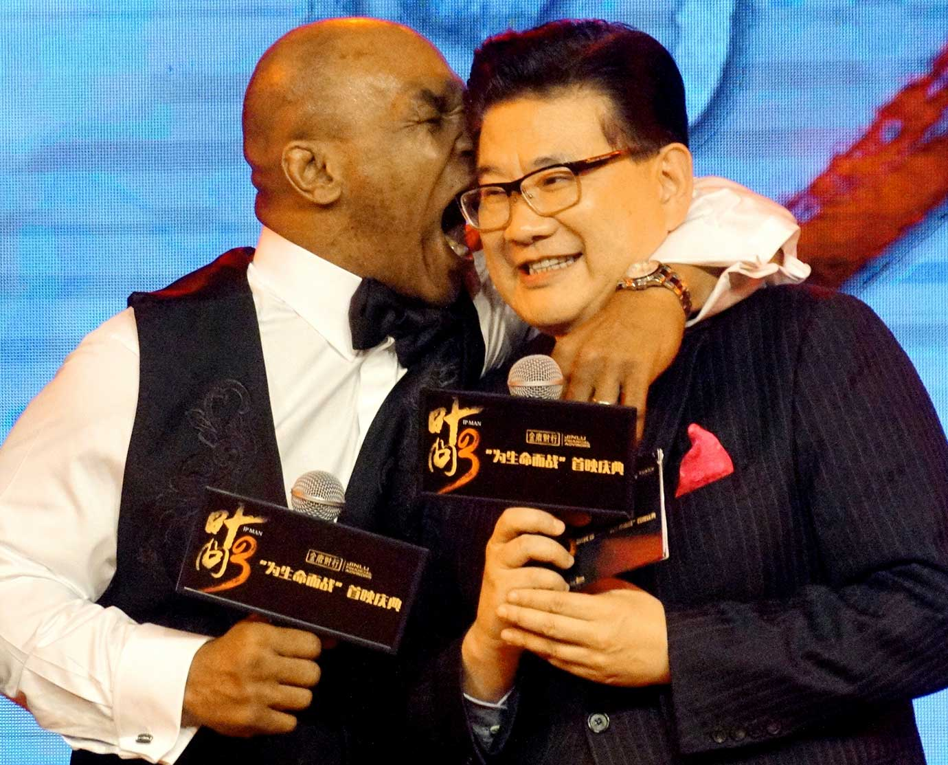 "Mike Tyson jokes with host Cao Kefan while at the premiere of director Wilson Yip's film ""Ip Man 3"" in Shanghai, China."