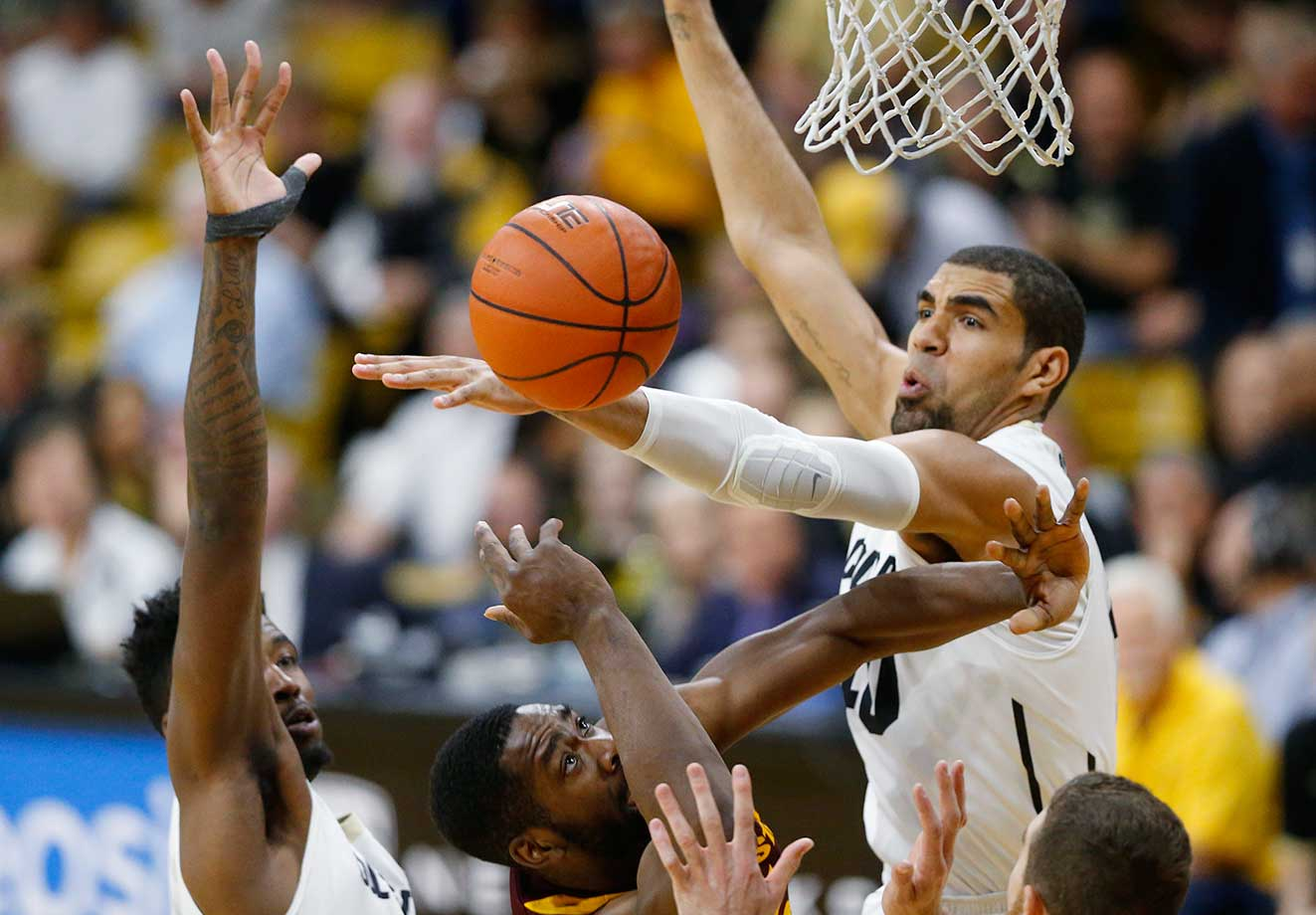 Colorado forward Josh Scott, right, blocks a shot by Arizona State forward Obinna Oleka.