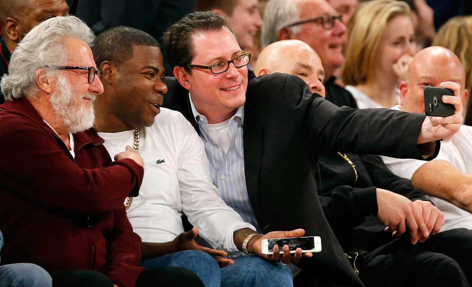 A fan snaps a selfie with comedian Tracy Morgan and actor Dustin Hoffman.