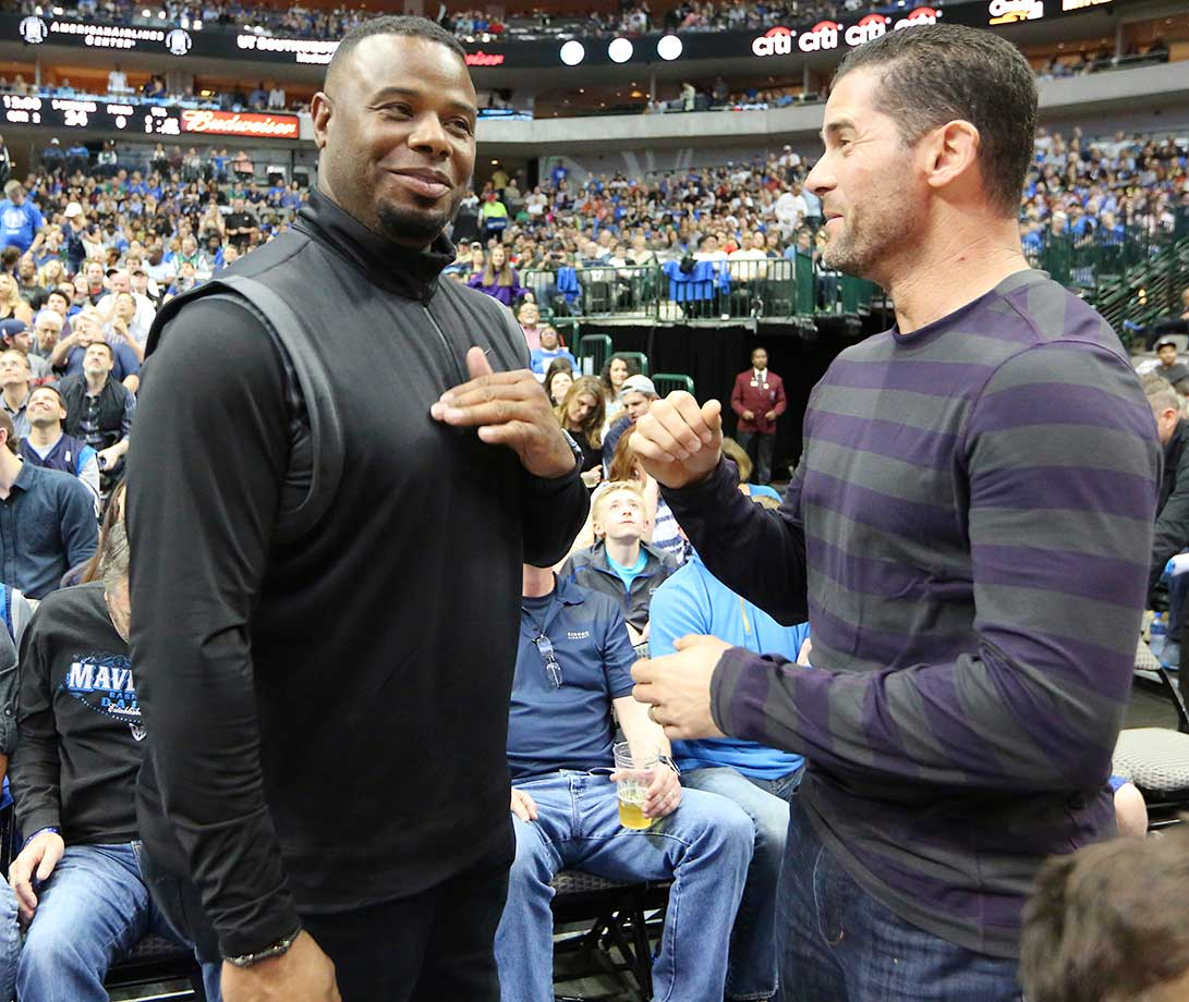 Former Major Leaguers Ken Griffey Jr. and Michael Young visit  during Mavs-Timberwolves game in Dallas.
