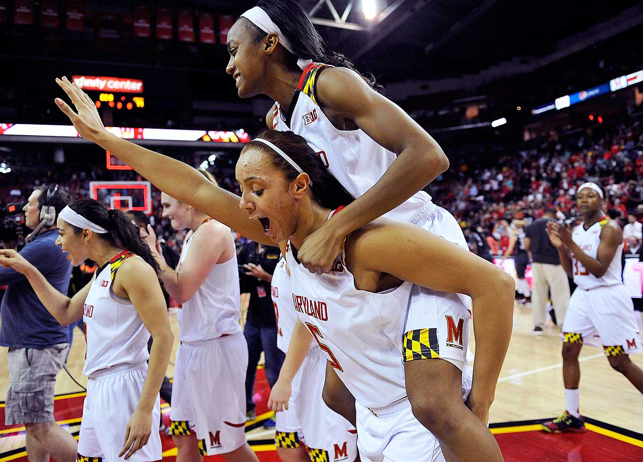 Malina Howard carries Shatori Walker-Kimbrough after Maryland defeated Minnesota to win the Big Ten regular season title.