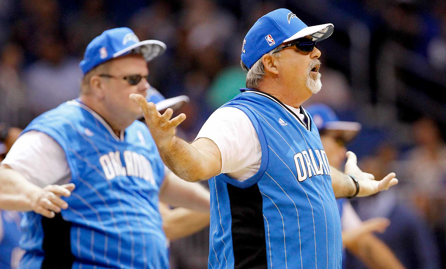 The fathers of the Orlando Magic cheerleaders perform during the game between Orlando and Philadelphia.