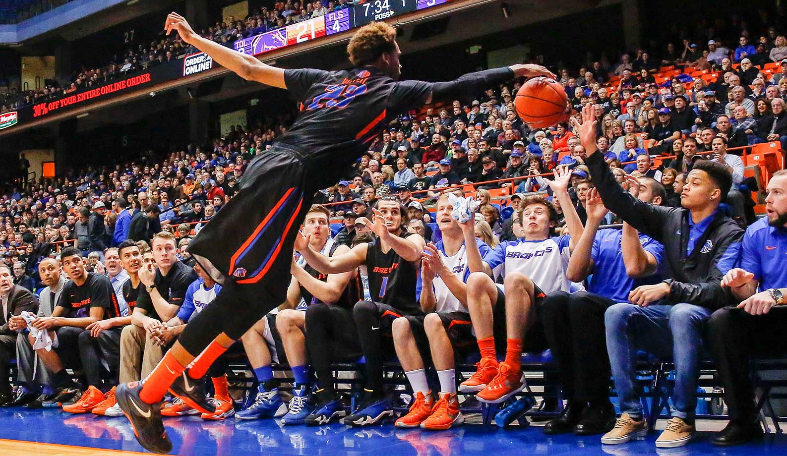 Boise State's James Webb III tries to stop a ball from going out of bounds against Utah State in Boise, Idaho. Boise State won 70-67.