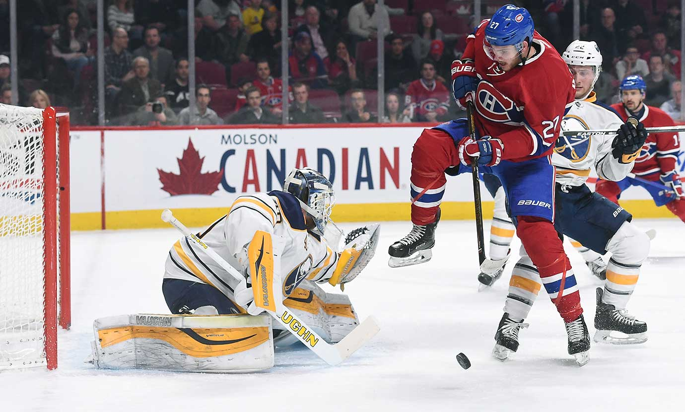 Alex Galchenyuk of the Montreal Canadiens attempts to deflect the puck against Robin Lehner of the Buffalo Sabres at the Bell Centre in Montreal, Quebec, Canada.