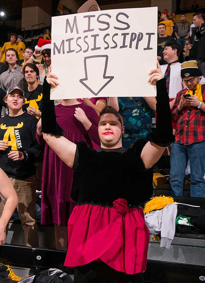 A dressed up Missouri fan greets the Mississippi team during introductions in Columbia, Mo.