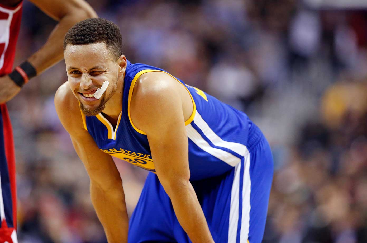 Golden State Warriors guard Stephen Curry winks at a fan in Washington. Curry scored 51 points with 11 three-pointers.