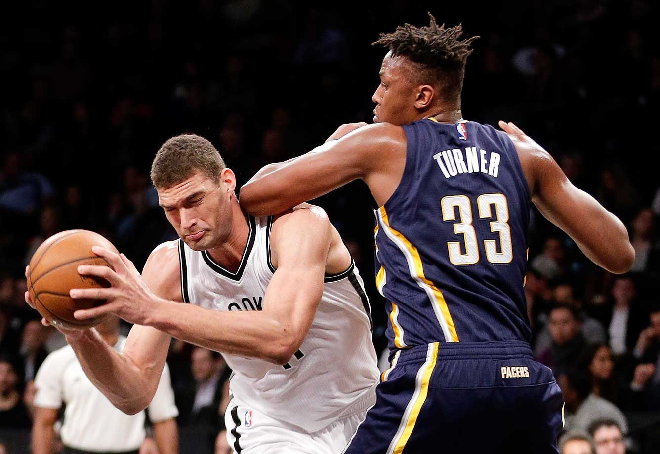Brooklyn Nets center Brook Lopez makes a move around Indiana Pacers forward Myles Turner in New York.