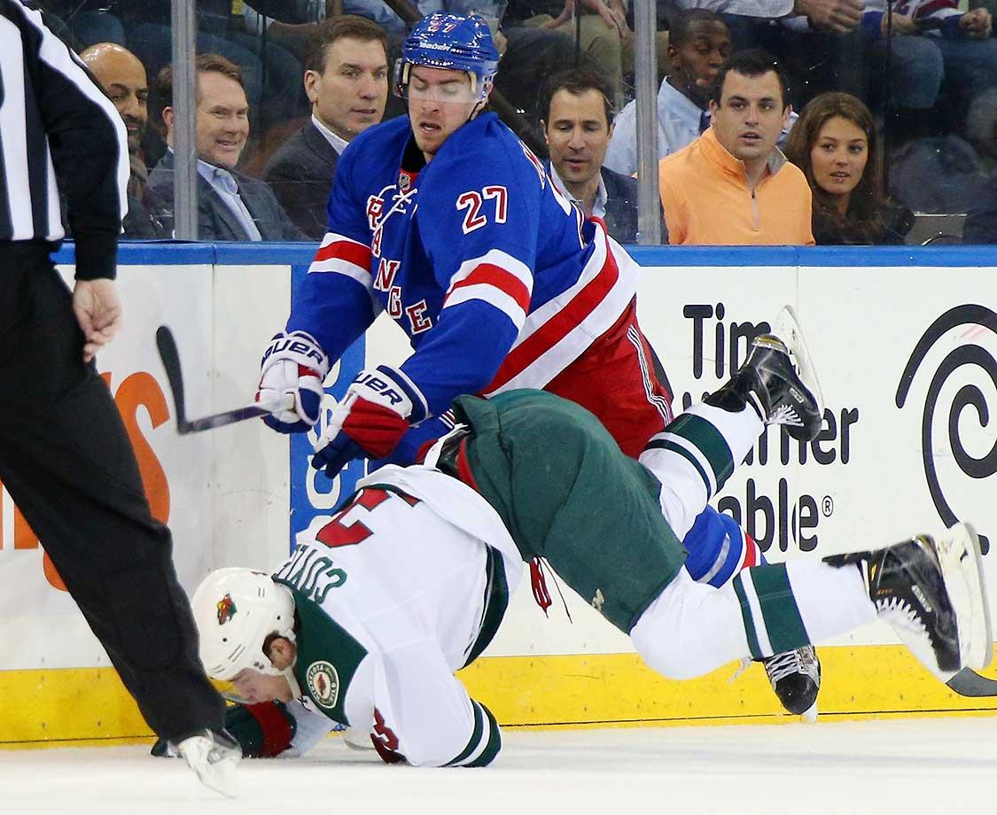 Ryan McDonagh of the New York Rangers checks Charlie Coyle of the Minnesota Wild at Madison Square Garden.