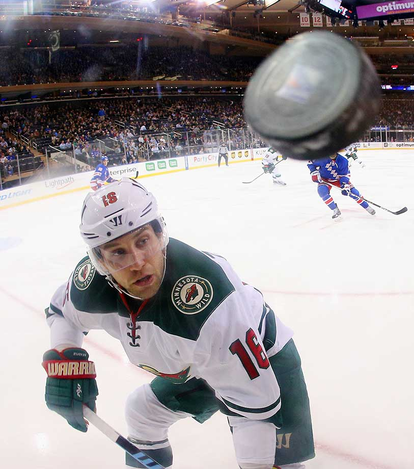Jason Zucker of the Minnesota Wild keeps his eyes on the puck during the game against the New York Rangers at Madison Square Garden.