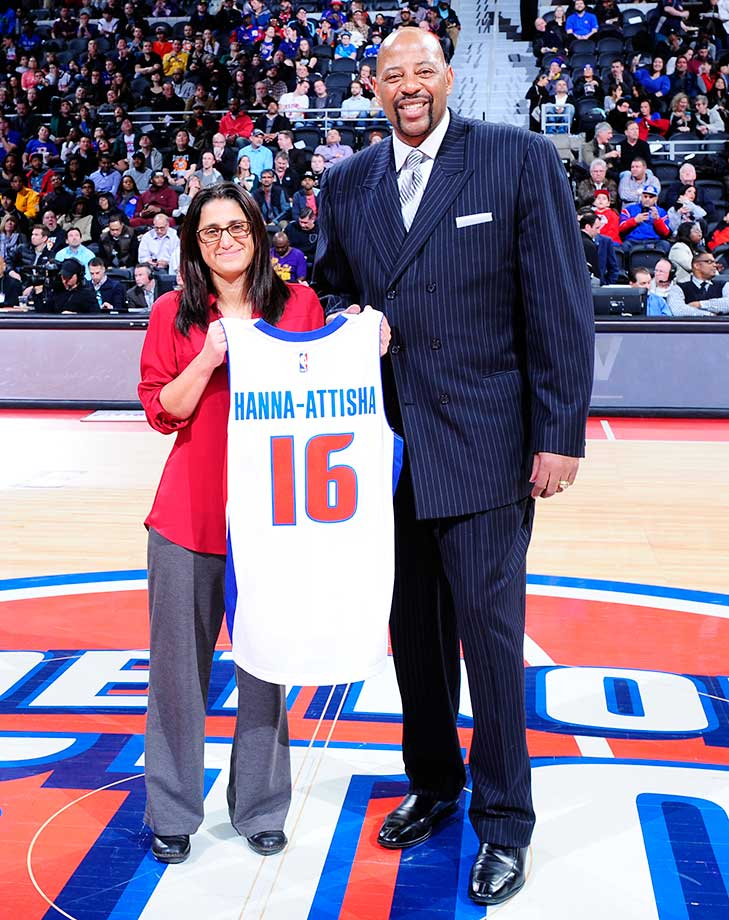 Dr. Mona Hanna-Attisha, the physician who helped expose the lead poisoning in the water in Flint, Mich., was presented with a jersey by Earl Cureton and the Detroit Pistons at Thursday night's game.
