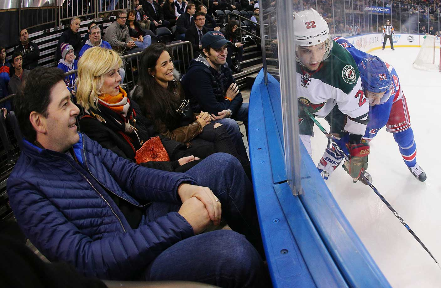 Fans watch the game between the New York Rangers and the Minnesota Wild at Madison Square Garden.