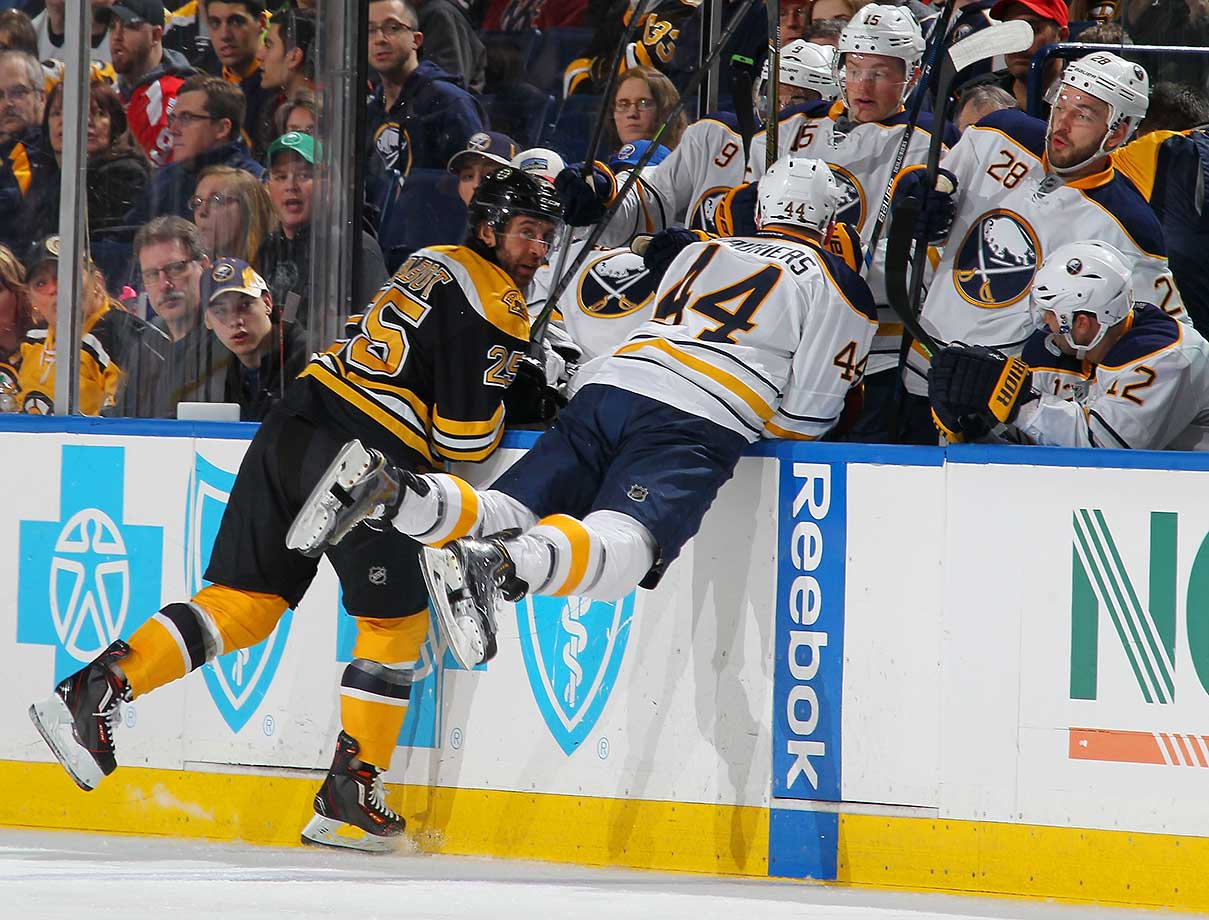Max Talbot of the Boston Bruins avoids a check from Nicolas Deslauriers of the Buffalo Sabres at the First Niagara Center in Buffalo.