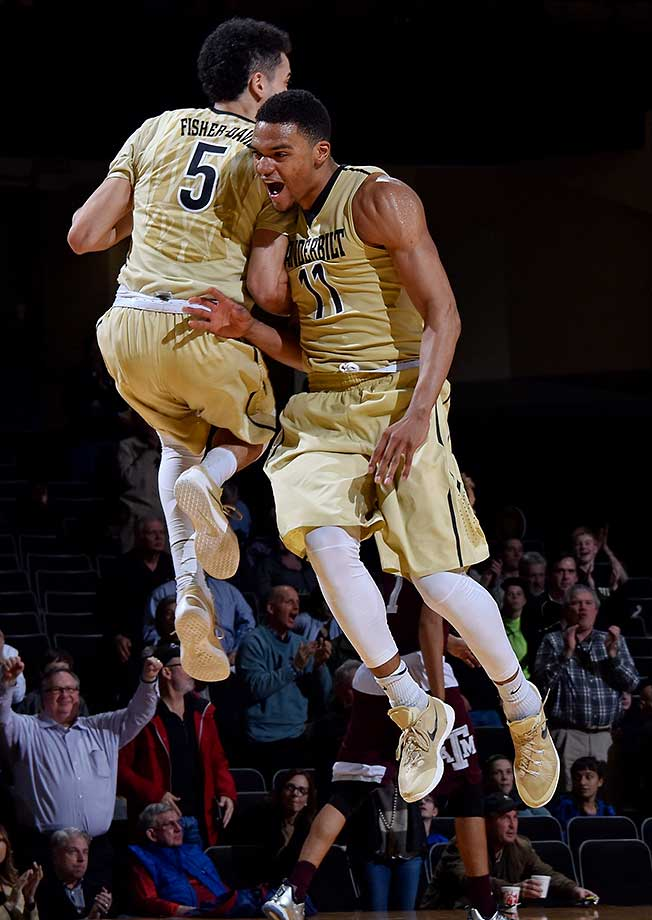 Jeff Roberson, right, of the Vanderbilt Commodores bounces off teammate Matthew Fisher Davis during a 77-60 upset of Texas A&M at Memorial Gym in Nashville.