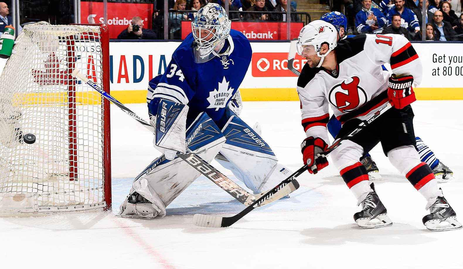 James Reimer of the Toronto Maple Leafs kicks a shot wide past Stephen Gionta of the New Jersey Devils at Air Canada Centre in Toronto.
