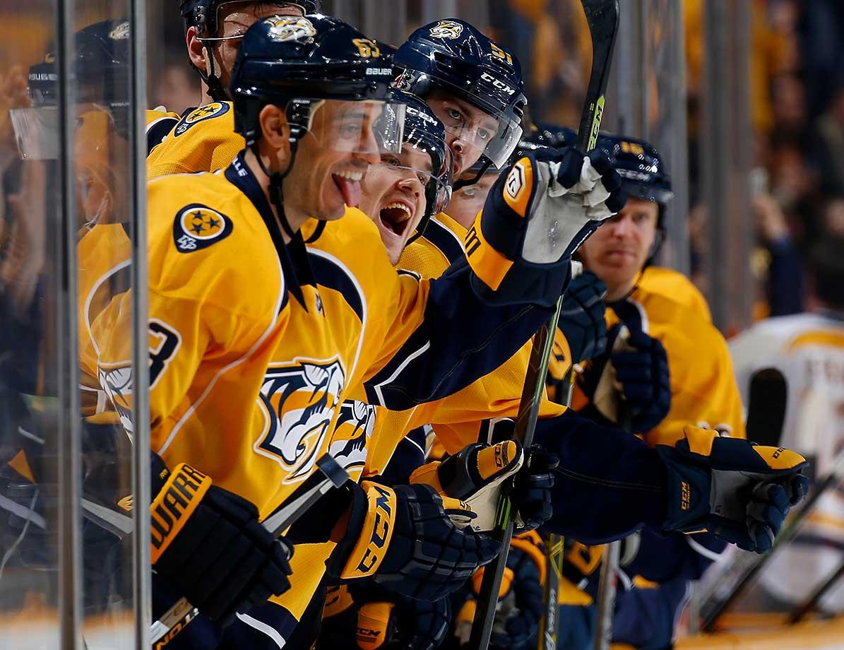 The Nashville Predators bench celebrates a goal by Ryan Johansen against the Philadelphia Flyers at Bridgestone Arena in Nashville.