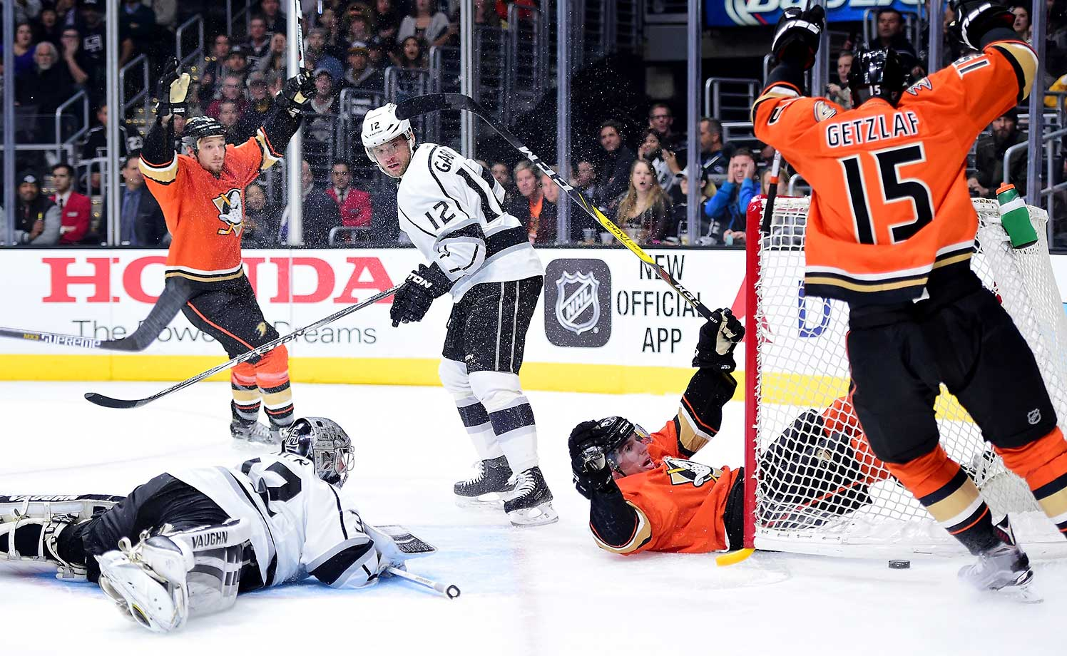 David Perron of the Anaheim Ducks reacts to his goal as he slides into the net behind Jonathan Quick and Marian Gaborik of the Los Angeles Kings for a 2-0 lead at Staples Center in Los Angeles.