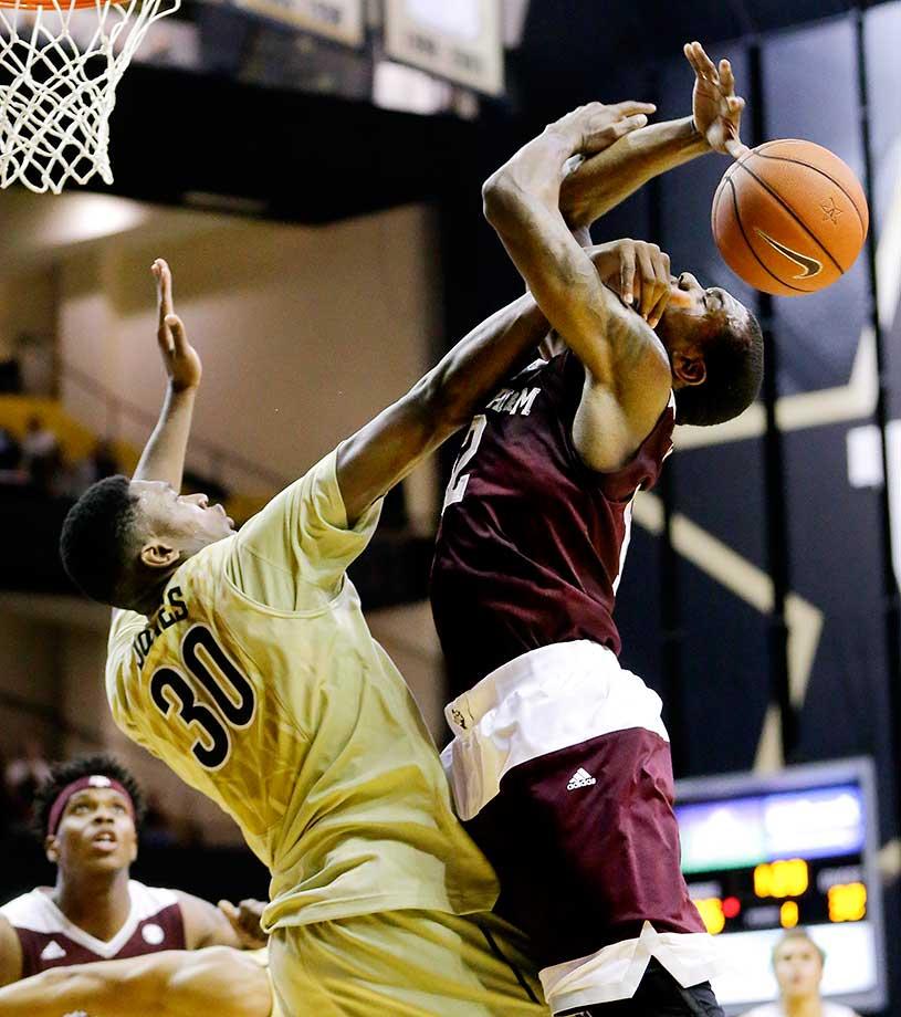 Vanderbilt center Damian Jones fouls Texas A&M guard Jalen Jones in Nashville, Tenn.