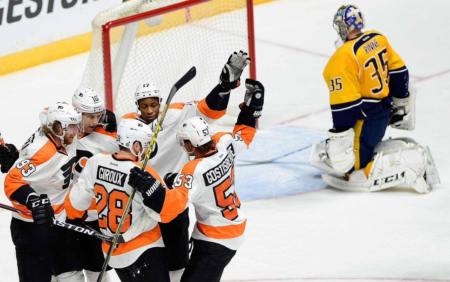 Philadelphia Flyers right wing Wayne Simmonds (17) celebrates with Brayden Schenn (10), Jakub Voracek (93), Claude Giroux (28) and Shayne Gostisbehere (53) after scoring a goal against Nashville Predators goalie Pekka Rinne in Nashville. The Flyers won 6-3.