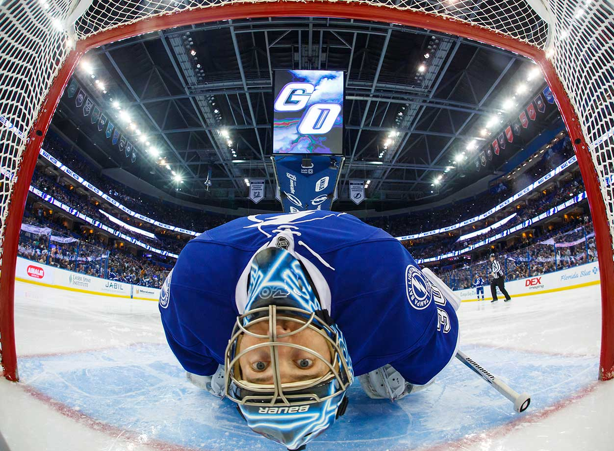 Goalie Ben Bishop of the Tampa Bay Lightning stretches before a game against the Pittsburgh Penguins.