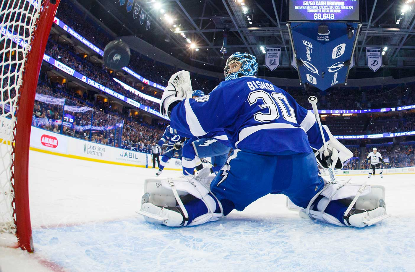 The puck flies by goalie Ben Bishop of the Tampa Bay Lightning for a goal in Friday's game against the Pittsburgh Penguins.