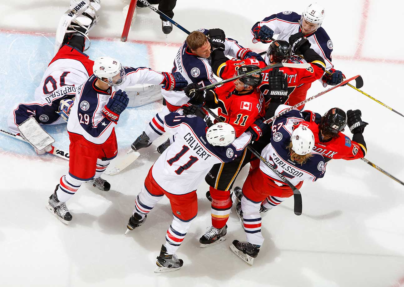 A scrum ensues after the whistle as the Calgary Flames faced off against the Columbus Blue Jackets at Scotiabank Saddledome in Calgary, Alberta, Canada.
