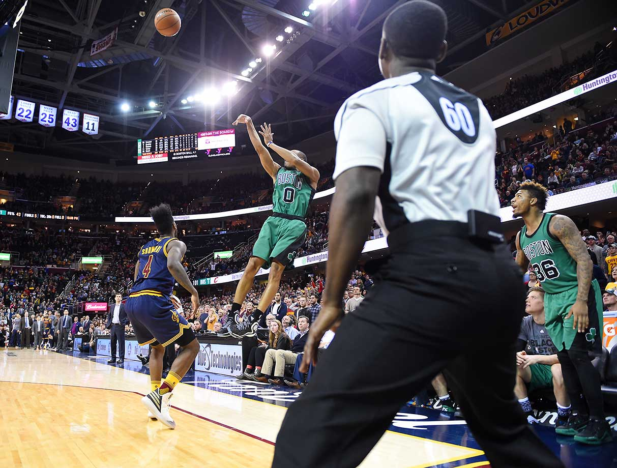 Avery Bradley of the Boston Celtics shoots the three-point shot that wins the game against the Cleveland Cavaliers at Quicken Loans Arena in Ohio.