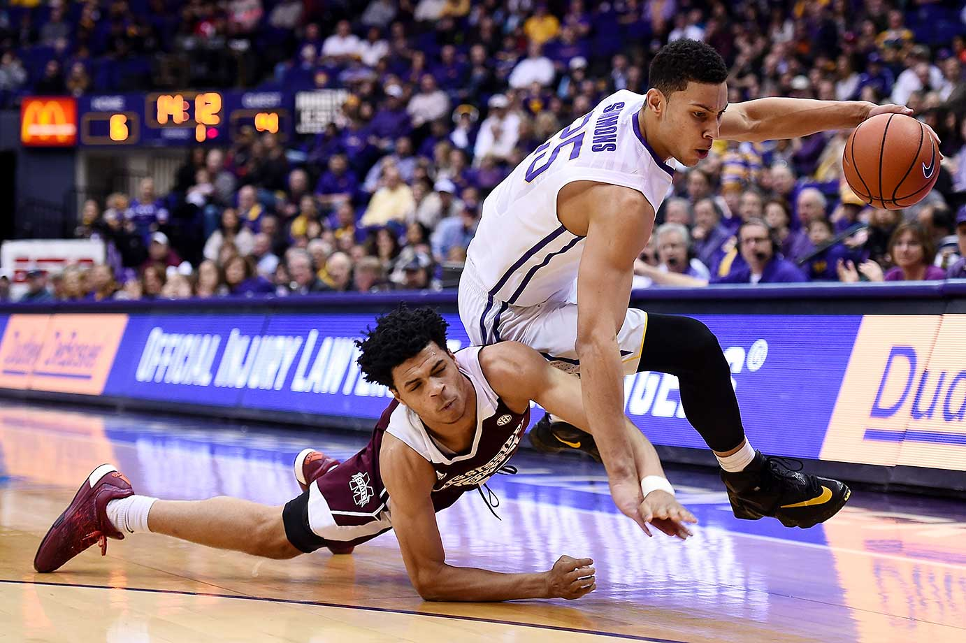 Ben Simmons of LSU is fouled by Quinndary Weatherspoon of Mississippi Statein Baton Rouge.
